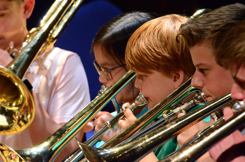 Lower School pupils playing brass instruments