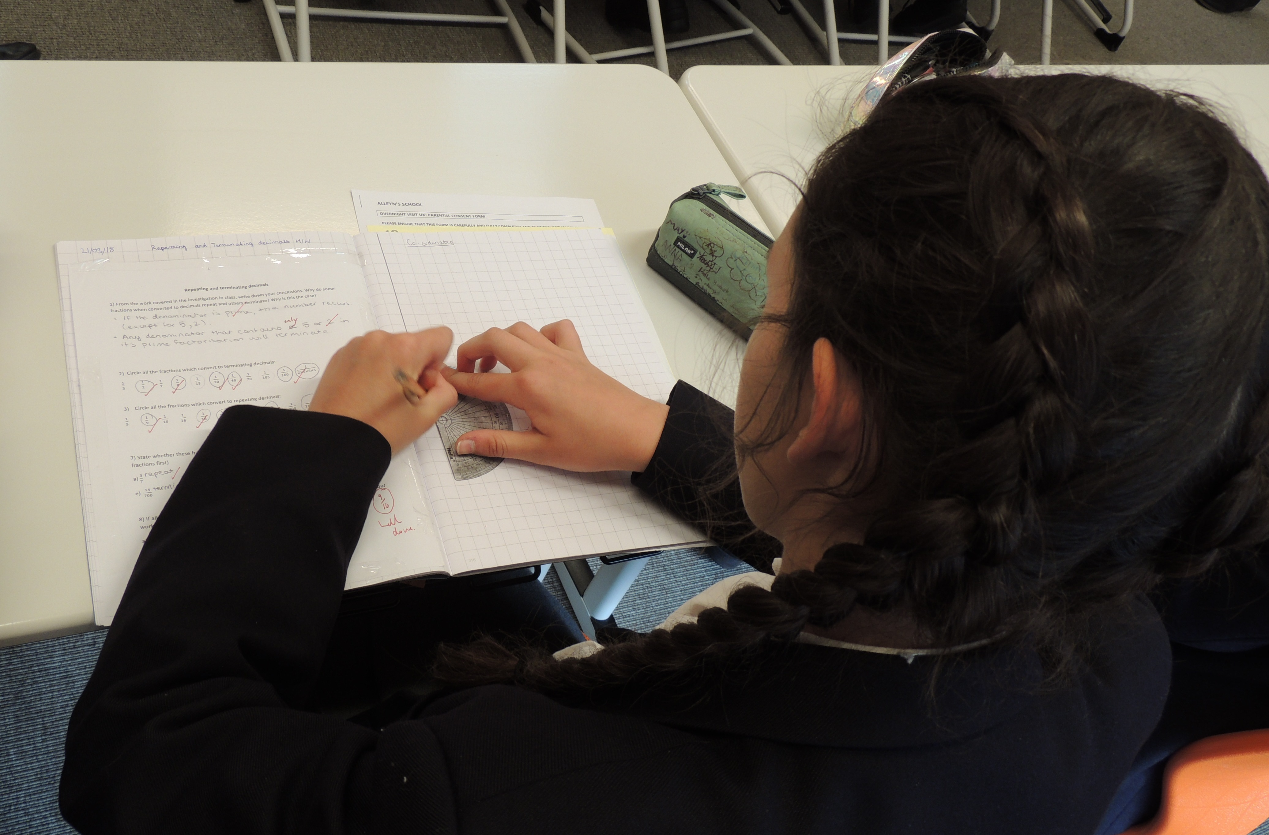 Female pupil taking part in a Maths lesson at Alleyn's