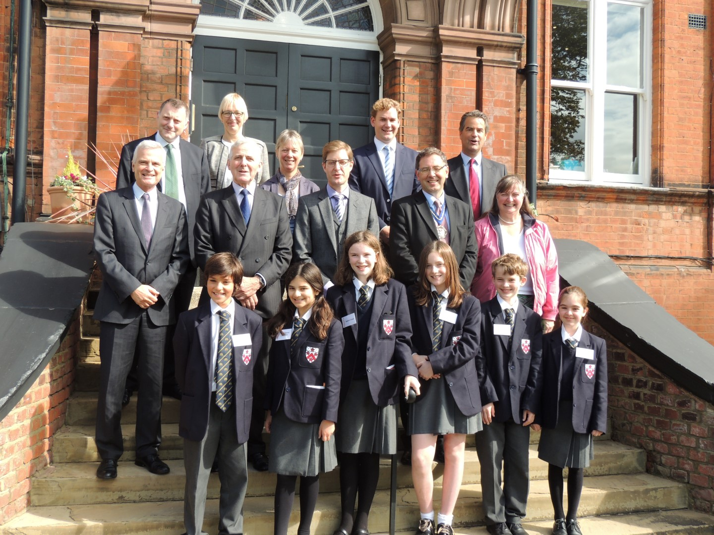 The Headmaster with Saddlers' Scholars on the School steps