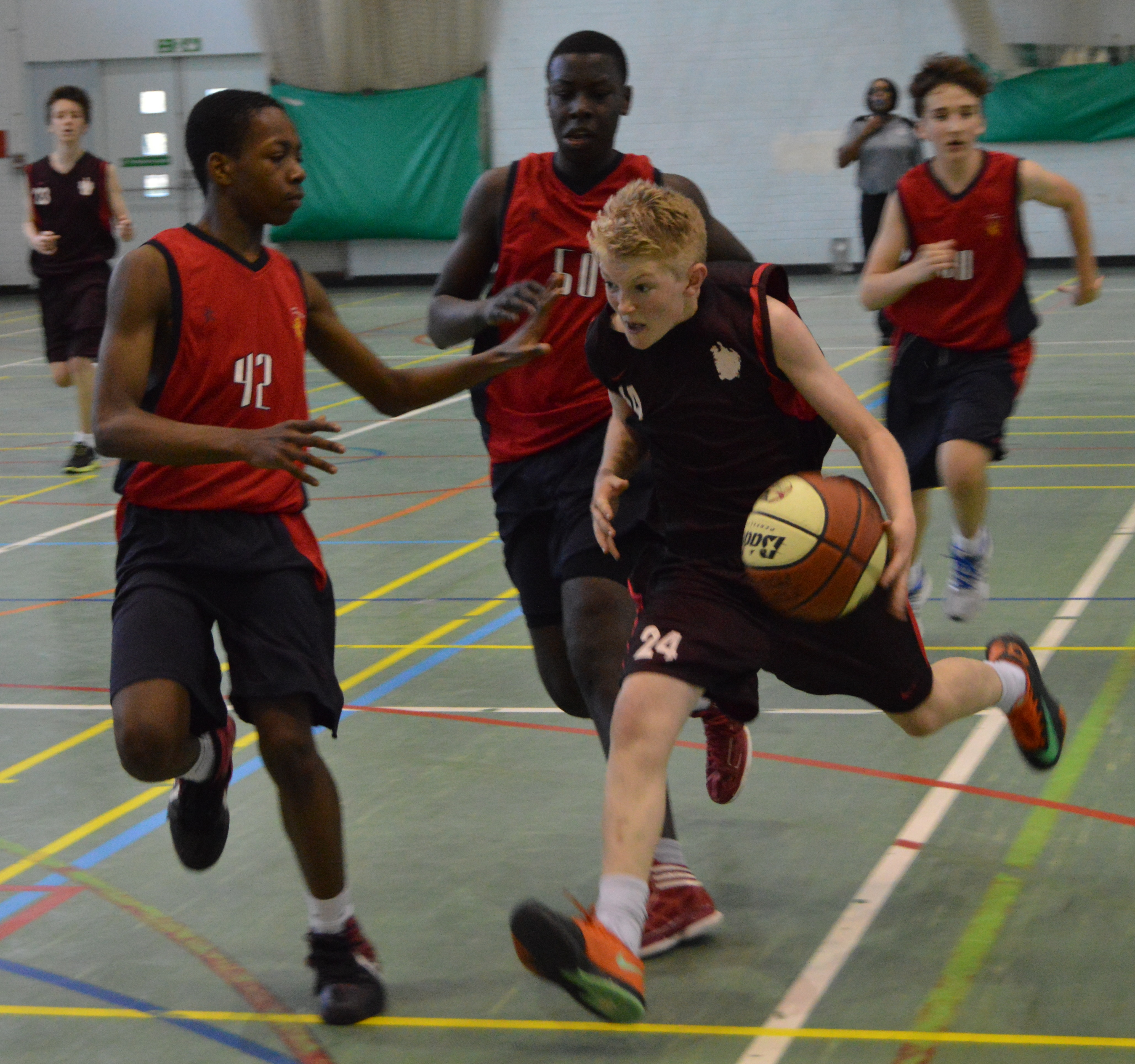Under 14 Alleyn's basketball player in action (in black)