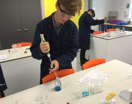 Pupils in the lab performing an experiment